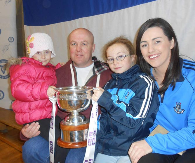 Molly, Gerry and Jill McNally with Skerries Harps All-Star Lyndsey Davey